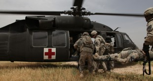 U.S. Army soldiers from 2nd Battalion, 12th Cavalry Regiment, 4th Brigade, 1st Cavalry Division, practice loading patients into a UH-60 Black Hawk helicopter during medical evacuation training at Contingency Operation Site Warrior, Kirkuk province, Iraq, May 6, 2011, in support of Operation New Dawn.  (Photo by: Spc. Sara Wakai)
